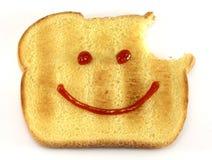 Pão com face e mordida felizes fotografia de stock royalty free