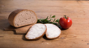 Pão com manteiga e tomate Imagem de Stock