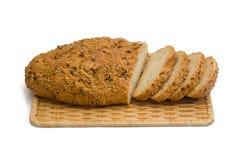 Pão cortado isolado no branco Foto de Stock