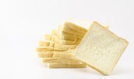Pão cortado isolado no branco Fotos de Stock