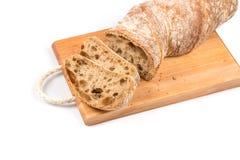 Pão cortado na placa de estaca Imagens de Stock Royalty Free
