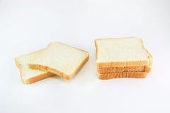 Pão cortado no branco Foto de Stock Royalty Free