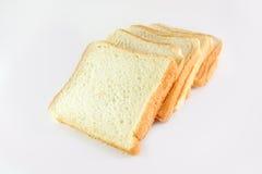 Pão cortado no branco Fotos de Stock