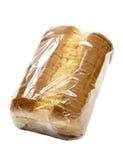 Pão cortado no envoltório plástico fotos de stock royalty free