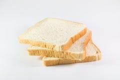 Pão cortado no fundo branco Fotos de Stock Royalty Free