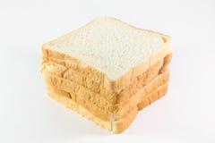 Pão cortado no fundo branco Foto de Stock