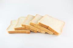 Pão cortado no fundo branco Imagens de Stock