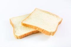 Pão cortado no fundo branco Fotografia de Stock