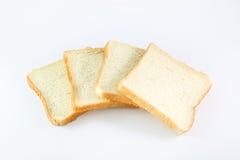 Pão cortado no fundo branco Imagem de Stock Royalty Free