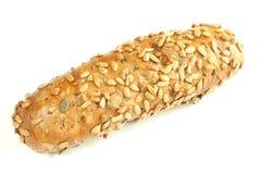 Pão cozido com as sementes de girassol isoladas no branco Fotografia de Stock Royalty Free