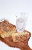 Pão da estaca e vidro da água mineral Fotografia de Stock Royalty Free