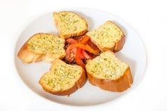 Pão de alho com tomates Fotos de Stock Royalty Free