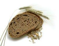 Pão de Brown, orelhas do centeio (pontos) e milho fotos de stock royalty free
