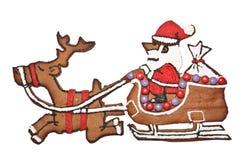 Pão-de-espécie Santa e rena com sledge Foto de Stock Royalty Free