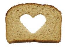 Pão de trigo inteiro saudável do coração Fotos de Stock