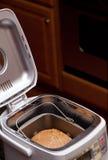 Pão do trigo cozido na máquina Fotografia de Stock Royalty Free