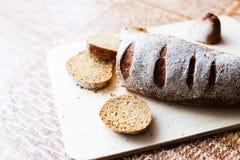 Pão do trigo mourisco na placa de madeira Imagem de Stock