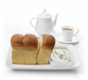 Pão e chá verde no fundo branco Fotos de Stock