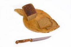 Pão e faca Foto de Stock