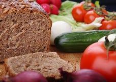 Pão e vegetais Imagens de Stock