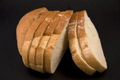 Pão em um fundo preto. Imagem de Stock