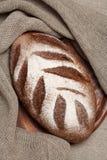 Pão em uma placa de madeira Imagem de Stock Royalty Free