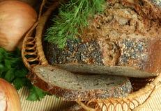 Pão escuro com sementes e com papoila Imagem de Stock Royalty Free