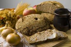 Pão espalhado com banha Imagens de Stock