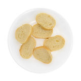 Pão francês cortado pequeno em uma placa branca Fotos de Stock Royalty Free