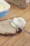Pão fresco com margarina fotografia de stock royalty free
