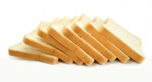 Pão fresco do corte no fundo branco fotografia de stock royalty free