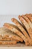 Pão inteiro cortado da grão Imagens de Stock