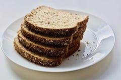 Pão na placa branca Foto de Stock