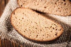 Pão na tabela de madeira Fotografia de Stock
