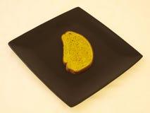Pão no preto Imagens de Stock