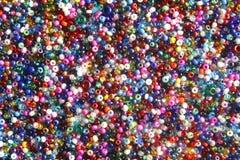 pärlor färgade mång- kärnar ur Royaltyfria Bilder