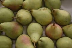 Päron är aptitretande En bakgrund från frukt Arkivbild