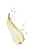 Päron i vatten med luftbubblor Fotografering för Bildbyråer