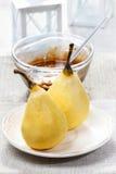 Päron med choklad Arkivfoto