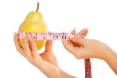 Päron med metern Arkivfoto
