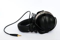 På-öra hörlurar Arkivbild