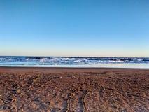 På den Quequen stranden arkivfoto