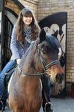 På hästrygg Royaltyfria Foton