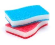 på köksvampar för vit två i blå och röd färg Fotografering för Bildbyråer
