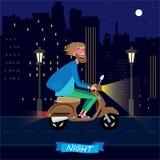På natten på en sparkcykel Arkivfoton