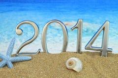 2014 på stranden Arkivfoto