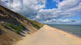 På stranden Arkivbild