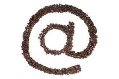 På symbolet av kaffebönor Arkivfoton