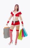 Påsar för shopping för härlig Santa Claus kvinna hållande royaltyfri fotografi