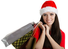 Påsar för shopping för julflicka bärande Arkivfoto